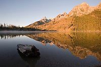 Steam rises off of String Lake as it reflects the Teton Range at sunrise Saturday in Grand Teton National Park.