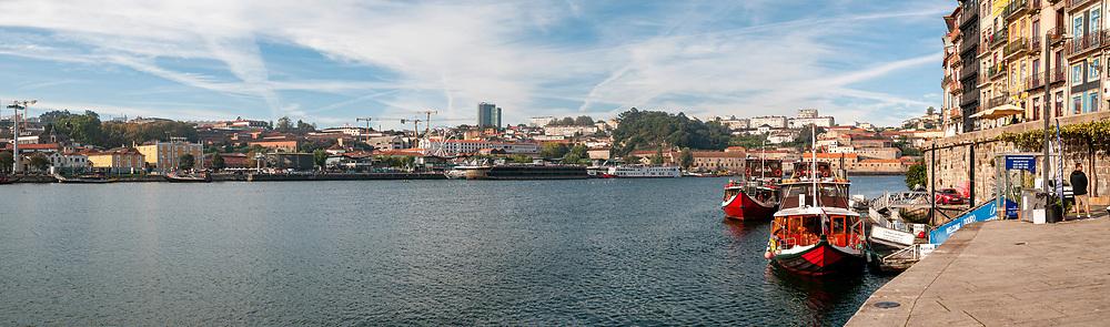 Douro River panorama with a partial view of Porto (right), and Vila Nova de Gaia (left), from Ribiera Square pier, Porto, Portugal.