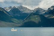 Fishing boat below mountains on Resurrection Bay, Seward, Alaska