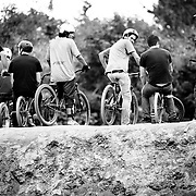 Zaid Elgawarsha looks back at the camera while resting with a group of riders at the dirt jump park in Bellingham, Washington.