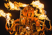 El Pulpo Mecanico's animated tentacles terrify and astound as they pump fire to the beat of a nearby art car's sound system at the 2013 Burning Man festival.