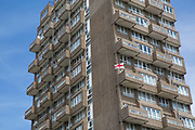 A St Georges Cross flag blows in the wind from a balcony at Holland Rise House on 15th June 2016 in London, United Kingdom.