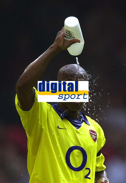 Photo: Richard Lane.<br />Arsenal v Manchester United. The FA Charity Shield 2003. 10/08/2003.<br />Silvain Wiltord cools off.