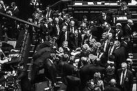 "Former Prime Minister of Italy Silvio Berlusconi is surrounded and greeted by members of Forza Italia, the center-right party he leads, before casting their vote to elect the new President of the Republic at the Italian Parliament in Rome, on April 20th 2013.<br /> <br /> Shortly after the 87-year-old President of the Republic Giorgio Napolitano became the first Italian president to be re-elected to serve a second term, after party leaders had failed to agree on his successor and begged him to stay on ""in the higher interests of the country"". In an unprecedented move which observers said raised Italy's chances of seeing the formation a broad coalition government<br /> <br /> ###<br /> <br /> Roma, aprile 2013. Silvio Berlusconi viene accolto dai deputati e senatori del Partito della Libertà nella Camera dei Deputati durante il voto della Camere riunite per l'elezione del Presidente della Repubblica."