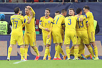 ROMANIA, Bucharest : Romania's players celebrate after scoring  a goal during the Euro 2016 Group F qualifying football match Romania vs Northern Ireland in Bucharest, Romania on November 14, 2014.