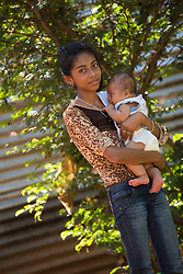 Central America, Nicaragua, Granada, teen with baby