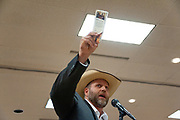Ammon Bundy, anti-government militia leader,  steps to the mike clutching his pocket constitution to ask a few questions of other speakers at the New Code of the West Conference, of which he was the featured speaker, held at the Grouse Mountain Lodge in Whitefish, Montana, Saturday, October 13, 2018.