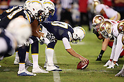 The San Diego Chargers offensive line gets set to snap the ball opposite the San Francisco 49ers defensive line at the line of scrimmage during the 2016 NFL preseason football game against the San Francisco 49ers on Thursday, Sept. 1, 2016 in San Diego. The 49ers won the game 31-21. (©Paul Anthony Spinelli)