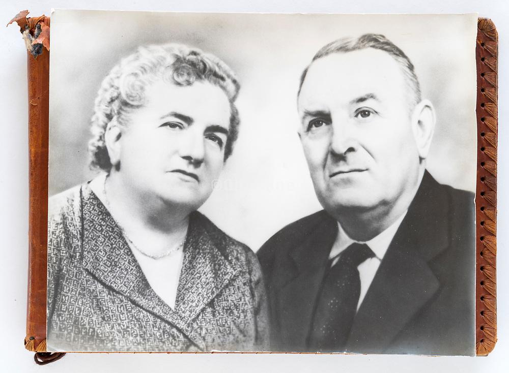 photo album with on top a large vintage photo elderly couple portrait France