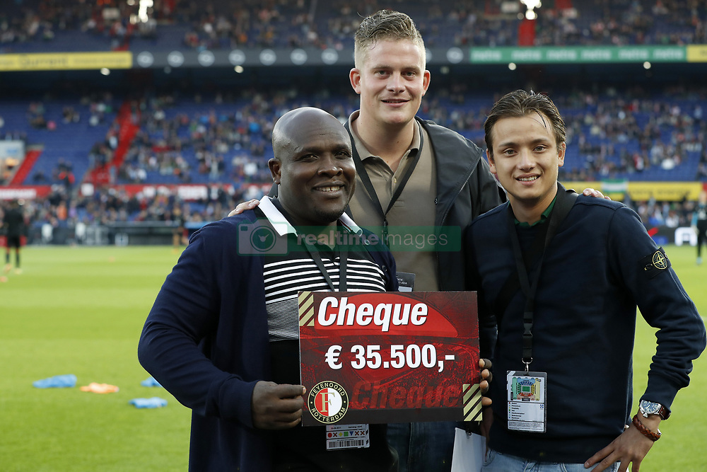 Christian Gyan is flanked by supporters of Feyenoord who have collected money for him during the Dutch Eredivisie match between Feyenoord Rotterdam and NAC Breda at the Kuip on September 23, 2017 in Rotterdam, The Netherlands