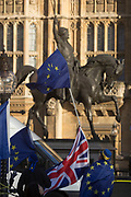 The stars of the EU flag fly over a London bus and the Houses of Parliament in Westminster, seat of government and power of the United Kingdom during Brexit negotiations with Brussels, on 1st December 2017, in Westminster, London, England.