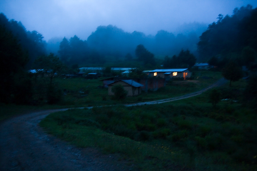 """Night falls in La Neveria, part of the Pueblos Mancomunados, a network Zapotec villages in the Sierra Norte Mountains, Oaxaca state, Mexico on July 13, 2008. The Pueblos Mancomunados, literally """"joint villages"""", welcome low-impact tourism with cabins, home stays and a large network of signposted trails and forest roads throughout the spectacular landscape which the communities share."""