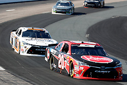 July 21, 2018 - Loudon, NH, U.S. - LOUDON, NH - JULY 21: Christopher Bell, Xfinity Series driver of the Rheem Toyota (20), stays in front of Ryan Preece, Xfinity Series driver of the Falmouth Ready Mix Toyota (18), during the Xfinity Series Lakes Region 200 on July 21, 2018, at New Hampshire Motor Speedway in Loudon, New Hampshire. (Photo by Fred Kfoury III/Icon Sportswire) (Credit Image: © Fred Kfoury Iii/Icon SMI via ZUMA Press)