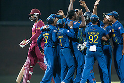 © Licensed to London News Pictures. 07/10/2012. The Sri Lankan team celebrate after getting out Chris Gayle during the World T20 Cricket Mens Final match between Sri Lanka Vs West Indies at the R Premadasa International Cricket Stadium, Colombo. Photo credit : Asanka Brendon Ratnayake/LNP