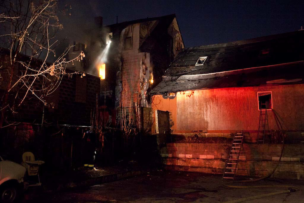 Somerville, MA 02/06/2012.The rear of a house and an adjacent garage on Jacques St. that ignited in a 2 alarm blaze on Monday evening..Wicked Local Photo by Alex Jones