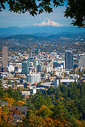 Portland, Oregon skyline from the Pittock Mansion.<br /> <br /> Portland, officially the City of Portland, is the largest and most populous city in the U.S. state of Oregon and the seat of Multnomah County. It is a major port in the Willamette Valley region of the Pacific Northwest, at the confluence of the Willamette and Columbia rivers. Approximately 2.4 million people live in the Portland metropolitan statistical area (MSA), making it the 25th most populous in the United States. Named after Portland, Maine, the Oregon settlement began to be populated in the 1830s near the end of the Oregon Trail. Its water access provided convenient transportation of goods, and the timber industry was a major force in the city's early economy. At the turn of the 20th century, the city had a reputation as one of the most dangerous port cities in the world, a hub for organized crime and racketeering. After the city's economy experienced an industrial boom during World War II, its hard-edged reputation began to dissipate. Beginning in the 1960s, Portland became noted for its growing progressive political values, earning it a reputation as a bastion of counterculture.<br /> <br /> The Portland Japanese Garden is a traditional Japanese garden occupying 12 acres, located within Washington Park in the West Hills of Portland, Oregon, United States. It is operated as a private non-profit organization, which leased the site from the city in the early 1960s. Stephen D. Bloom has been the chief executive officer of the Portland Japanese Garden since 2005.