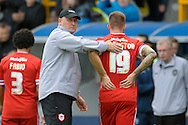 Cardiff City Manager Russell Slade with Anthony Pilkington of Cardiff City after the final whistle.  Skybet football league championship match , Millwall v Cardiff city at the Den in Millwall, London on Saturday 25th October 2014.<br /> pic by John Patrick Fletcher, Andrew Orchard sports photography.
