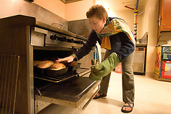 Stanford after dark. Stanford sophmore, Katherine Roubos, bakes bread at Columbay co-op.