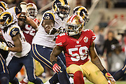 San Francisco 49ers outside linebacker Eli Harold (58) tries to get past the Los Angeles Rams defense at Levi's Stadium in Santa Clara, Calif., on September 12, 2016. (Stan Olszewski/Special to S.F. Examiner)