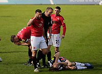 Football - 2020 / 2021 Sky Bet League Two - Morecambe vs. Bolton Wanderers<br /> <br /> Referee Carl Boyeson stands over Michael Jordan Williams of Bolton Wanderers after Williams had been fouled by Nat Knight-Percival of Morecambe, at the Mazuma Stadium.<br /> <br /> COLORSPORT/ALAN MARTIN