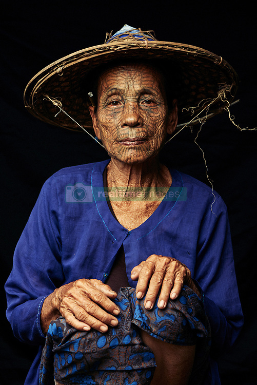 "Polish photographer, Adam Koziol has travelled all over the world to document ancient and primitive tribes. This time, he has captured the beauty and magic of the Chin tribe in Chin State in Burma. The women photographed in his photos come from the last generation of the Chin tribe who have their faces tattooed.<br /> <br /> The Chin tribe came about when decades ago, the Burmese king would travel to the area inhabited by women from the Chin tribe. He was in awe of what he saw and because it left such a big impression on him, he kidnapped on of the girls. From then on, Chin families started to tattoo their daughters faces and other parts of their body to make sure they would never be kidnapped. Girls between the ages of 12 and 14 would also have their ears pierced so they could wear bigger earrings – a symbol of feminine beauty but also so they could become part of the tribe and be less appealing to the Burmese king. It would take more than a day for the girls to have their faces tattooed and was an extremely painful process – especially on their eyelids. <br /> <br /> The tattoos are not made with ink, but rather with leaves, grass shoots and soot. The mixture was then tattooed on with sharp cane thorns. The Burmese socialist government put a ban on this tradition in the 60s. <br /> <br /> ""I want to show the beauty of cultures and the variety of origins of people from all over the world. I am fascinated in particular by tattoos and scarification's of tribes"" says Adam. ""I develop relationships with people before creating photos and spend as much time with them as possible, really getting to know them and their culture."""