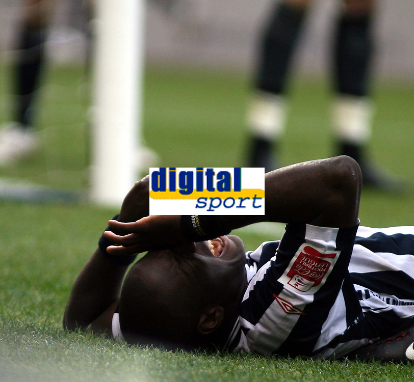 Photo: Mark Stephenson/Sportsbeat Images.<br /> West Bromwich Albion v Wolverhampton Wanderers. Coca Cola Championship. 25/11/2007.West Brom's Ishmael Miller the side lines after a bad challenge