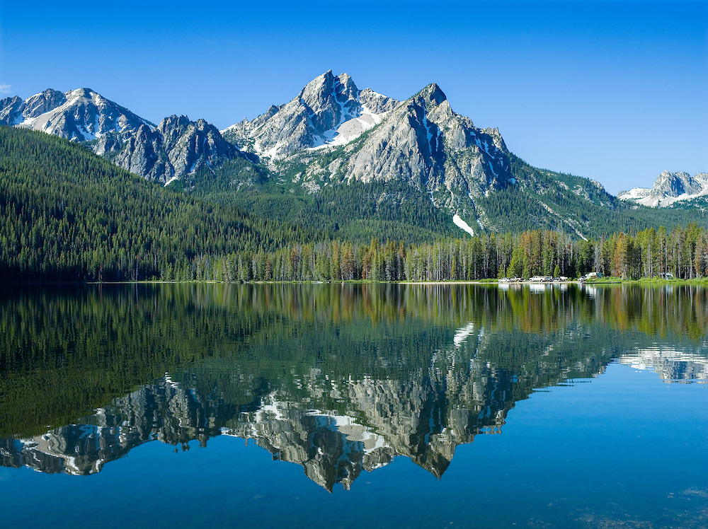 McGown Peak at 9860 feet 3005 meters reflects in the tranquil surface of Stanley Lake in the Sawtooth Mountain Range near Stanley Idaho.  Recreation area for boating, fishing, camping, hiking, rock climbing, backpacking.Licensing and Open Edition Prints.