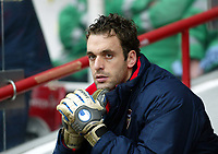 Photo. Chris Ratcliffe, Digitalsport<br /> Arsenal v Stoke City. FA Cup Third Round. <br /> 09/01/2005<br /> Manuel Almunia watches from the becnh as Wenger continues to change the keeper around.