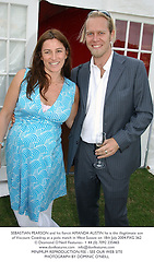 SEBASTIAN PEARSON and his fiancé AMANDA AUSTIN he is the illegitimate son of Viscount Cowdray, at a polo match in West Sussex on 18th July 2004.PXG 362