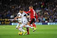Angel Rangel of Swansea City is challenged by Craig Bellamy of Cardiff City.<br /> Barclays Premier League match, Cardiff city v Swansea city at the Cardiff city stadium in Cardiff, South Wales on Sunday 3rd Nov 2013. pic by Phil Rees, Andrew Orchard sports photography,
