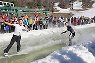 Warwick, NY - Two snowboarders cross the water at the end of a run during the Spring Rally at Mount Peter in Warwick on March 29, 2008.