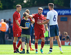 BURY, ENGLAND - Saturday, July 14, 2018: Liverpool's Adam Lallana with a young supporter on the pitch after a preseason friendly match between Bury FC and Liverpool FC at Gigg Lane. (Pic by Paul Greenwood/Propaganda)