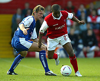 Photo. Andrew Unwin<br /> Rotherham v Millwall, Nationwide League Division One, Millmoor Lane, Rotherham 11/10/2003.<br /> Rotherham's Darren Byfield (r) looks to go past Millwall's David Ward (l).