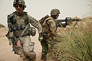 Staff Sergeant Dennis Johnson runs down the fire line during a firefight with Afghan insurgents.