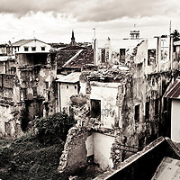 "Stone Town, Zanzibar 05 November  2010<br /> Old buildings of Stone Town.<br /> Stone Town or Mji Mkongwe, in Swahili meaning ""ancient town"", is the old part of Zanzibar City, the capital of the island of Unguja, informally known as Zanzibar, part of Tanzania. The town was the centre of trade on the East African coast between Asia and Africa before the colonization of the mainland in the late 19th century after which the focus moved to Mombasa and Dar es Salaam. From 1840 to 1856, Said bin Sultan had the capital of the Omani Empire in Stone Town. The main export was spices and particularly cloves. For many years Stone Town was a major centre for the slave trade; slaves were obtained from mainland Africa and traded with the Middle East. The town also became a base for many European explorers, particularly the Portuguese, and colonizers from the late 19th century. David Livingstone used Stone Town as his base for preparing for his final expedition in 1866. A house, now bearing his name, was lent by Sultan Seyyid Said. Immigrant communities from Oman, Persia and India lived here. <br /> Photo: Ezequiel Scagnetti"
