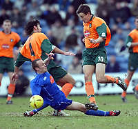 Photo. Aidan Ellis.<br /> Stockport County v Plymouth Argyle.<br /> Nationwide Division 2.<br /> 24/01/2004.<br /> Plymouth's Ian Stonebridge, David Frio and Stockport's Fraser McLachlan