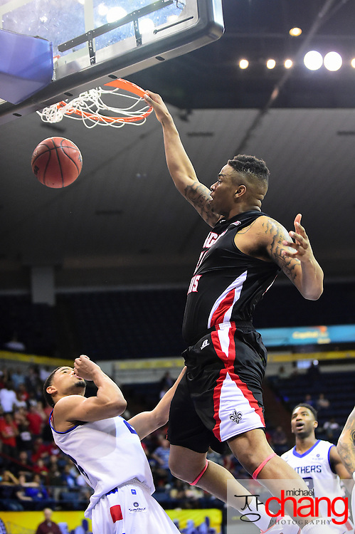 NEW ORLEANS, LA - MARCH 16: Shawn Long #21 of the Louisiana Lafayette Ragin Cajuns dunks the ball over Manny Atkins #23 of the Georgia State Panthers during the championship game of the 2014 Men's Sunbelt Basketball Tournament at Lakefront Arena on March 16, 2014 in New Orleans, Louisiana. Louisiana Lafayette defeated GA State 82-81. (Photo by Michael Chang/Getty Images) *** Local Caption *** Shawn Long; Manny Atkins