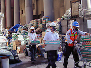 """Food and water are piled on the steps of St.Peters where trinity cemetery is and volunteers carry supplies in tto trinity church Friday  Sept.15,2001. Through my eyes and with my camera I am able to see the world we live in, and try to bring things into focus. Photography preserves my vision of what """"I see"""" at a specific time and place- a moment. Creating a bond between  me and my subject and capturing and emotion for eternity. Having lived and worked in New York City for over 15 years when 911 happened. I had to go and """"see"""" with my camera what lower Manhattan was like after this horrific attack on our Nation. The World Trade Center owned the skyline in lower Manhattan making it feel more like a canyon. After the Twin Towers fell, and I saw with my own eyes and camera the destruction, I realized what little land they actually sat on. The Twin Towers may not have occupied a large plot of land but they now touched everyones life. Photo©SuziAltman"""