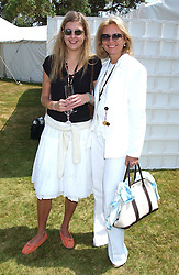 """Left to right, CAROLINE RUPERT and her mother MRS JOHANN RUPERT wife of the Chief Executive of Richemont at a luncheon hosted by Cartier at the 2005 Goodwood Festival of Speed on 26th June 2005.  Cartier sponsored the """"Style Et Luxe' for vintage cars on the final day of this annual event at Goodwood House, West Sussex. <br /><br />NON EXCLUSIVE - WORLD RIGHTS"""