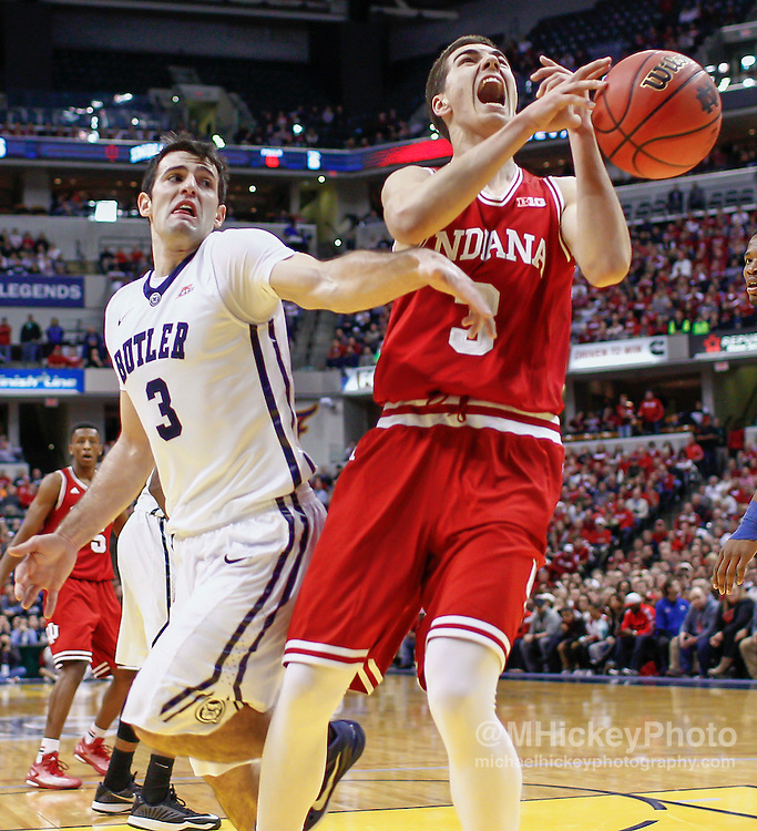 INDIANAPOLIS, IN - DECEMBER  20: Max Hoetzel #3 of the Indiana Hoosiers has the ball knocked away by Alex Barlow #3 of the Butler Bulldogs at Bankers Life Fieldhouse on December 20, 2014 in Indianapolis, Indiana. Indiana defeated Butler 82-73. (Photo by Michael Hickey/Getty Images) *** Local Caption *** Max Hoetzel; Alex Barlow