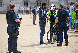 © Licensed to London News Pictures. 16/07/2016. London, UK. Armed police question a man at a parade on Horseguards Parade in Westminster, London two days after more than 80 people were killed in a terrorist attack in Nice, southern France. Photo credit: Ben Cawthra/LNP