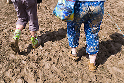 Festival goers forced to wear Wellington boots when heavy rain brings muddy ground at WOMAD (World of Music; Arts and Dance) Festival; Charlton Park; Malmesbury; 2007,