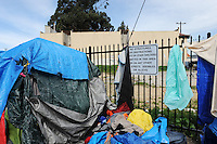 Tents covered with tarps help protect residents from winter weather in the Chinatown area of Salinas on March 8, 2016.
