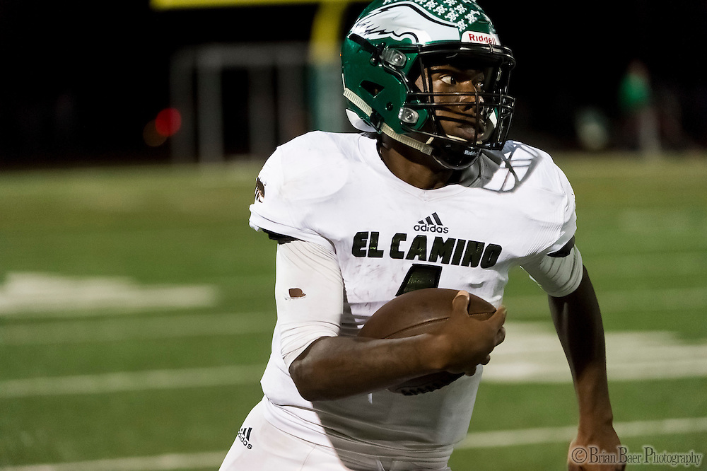 El Camino Eagles Antoine Fleming (1), runs with the ball during the third quarter as the El Camino Eagles host the Rio Americano Raiders at Del Campo High School, Friday Oct 7, 2016. <br /> photo by Brian Baer