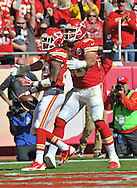 KANSAS CITY, MO - OCTOBER 27:  Wide receiver Dexter McCluster #22 of the Kansas City Chiefs celebrates with teammate Anthony Fasano #80 after catching a 28-yard touchdown pass against the Cleveland Browns during the first half on October 27, 2013 at Arrowhead Stadium in Kansas City, Missouri.  (Photo by Peter Aiken/Getty Images) *** Local Caption *** Dexter McCluster;Anthony Fasano