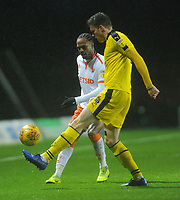 Blackpool's Nathan Delfouneso vies for possession with Oxford United's Rob Dickie<br /> <br /> Photographer Kevin Barnes/CameraSport<br /> <br /> The EFL Sky Bet League One - Oxford United v Blackpool - Saturday 15th December 2018 - Kassam Stadium - Oxford<br /> <br /> World Copyright © 2018 CameraSport. All rights reserved. 43 Linden Ave. Countesthorpe. Leicester. England. LE8 5PG - Tel: +44 (0) 116 277 4147 - admin@camerasport.com - www.camerasport.com