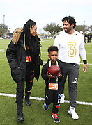 Seattle Seahawks quarterback Russell Wilson (3) (right) walks with wife Ciara (left) and stepson Future Wilburn after NFC practice at ESPN Wide World of Sports on Wednesday, Jan 22, 2020, in Kississimee, Fla. (Steve Jacobson/Image of Sport)
