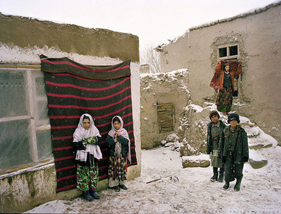 Relatives of the groom, at the bride's house in Khandut. Wedding celebration of Dodé Khuda..Wakhi wedding ceremonies usually takes place in the winter months. The Wakhi do most of their business with Afghan Kyrgyz.