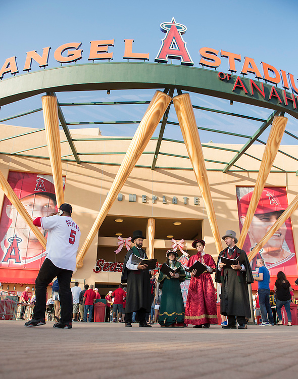 Carolers sing in front of Angel Stadium during the Angels' Christmas in June promotion Friday.<br /> <br /> ///ADDITIONAL INFO:   <br /> <br /> angels.0625.kjs  ---  Photo by KEVIN SULLIVAN / Orange County Register  --  6/24/16<br /> <br /> The Los Angeles Angels take on the Oakland Athletics Friday at Angel Stadium.<br /> <br /> <br />  6/24/16