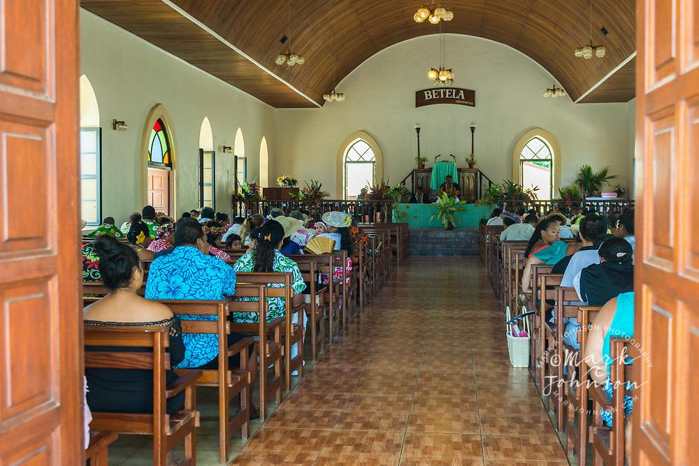 Local residents attending the Faanui Bay village church, Bora Bora, Leeward Islands, French Polynesia